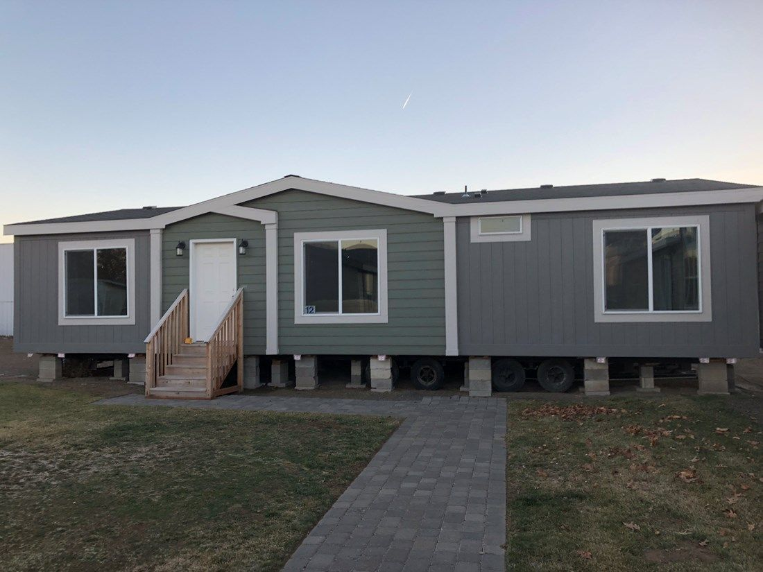 The 2018 COLUMBIA RIVER Exterior. This Manufactured Mobile Home features 3 bedrooms and 2 baths.