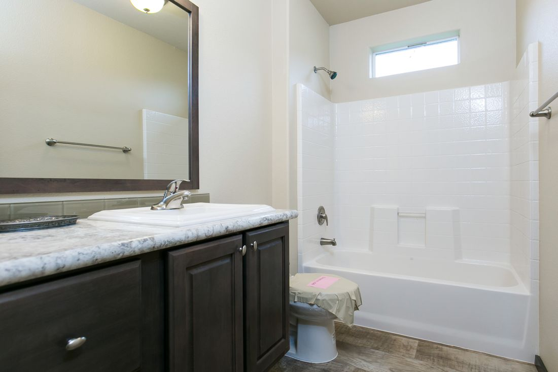 The 2021 COLUMBIA RIVER Guest Bathroom. This Manufactured Mobile Home features 3 bedrooms and 2 baths.