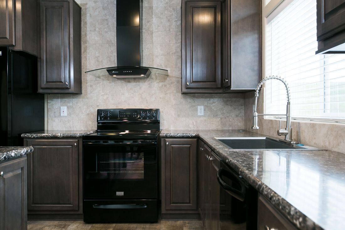 The 2021 COLUMBIA RIVER Kitchen. This Manufactured Mobile Home features 3 bedrooms and 2 baths.
