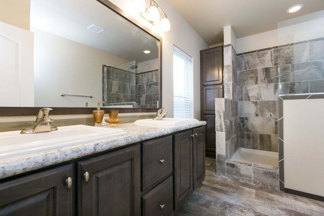 The 2021 COLUMBIA RIVER Master Bathroom. This Manufactured Mobile Home features 3 bedrooms and 2 baths.