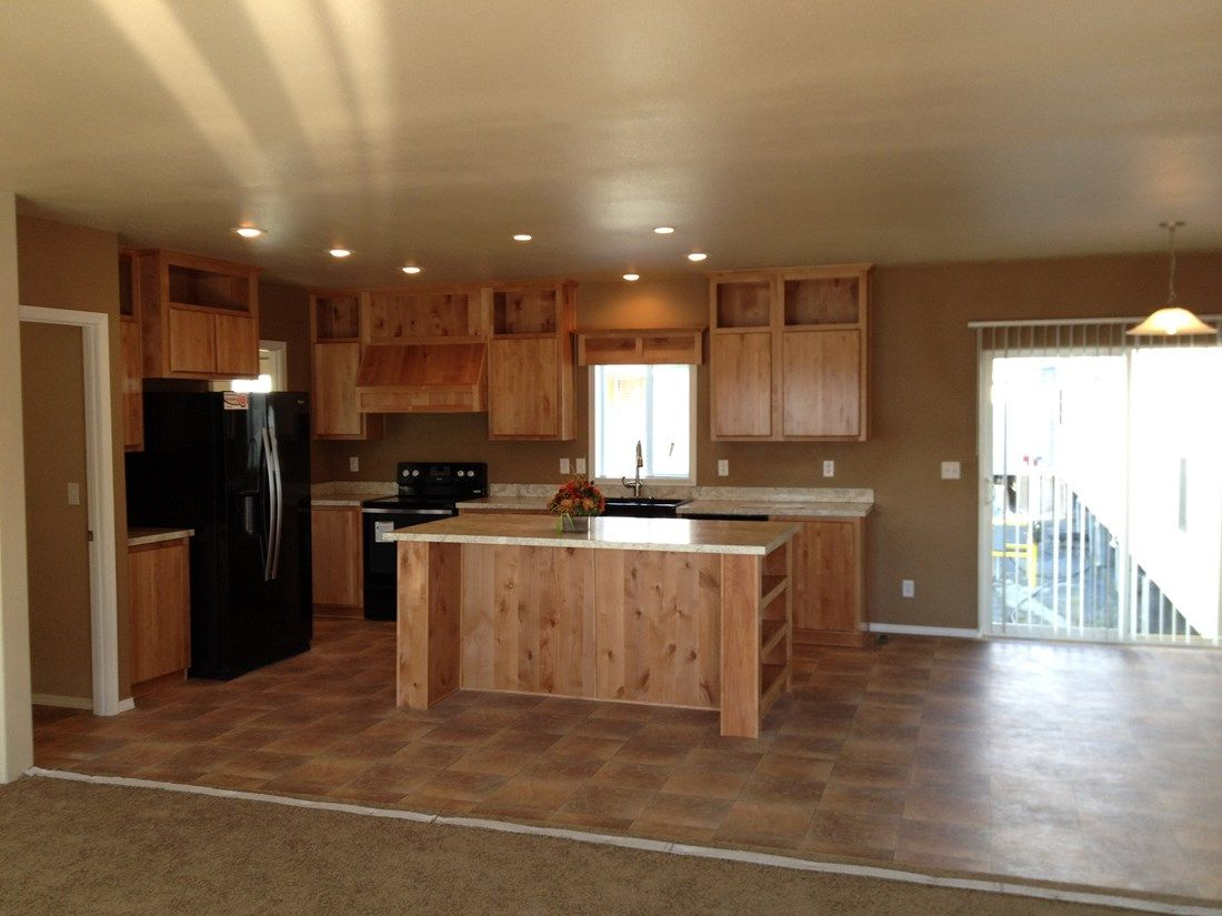 The 2026 COLUMBIA RIVER Kitchen. This Manufactured Mobile Home features 4 bedrooms and 2 baths.