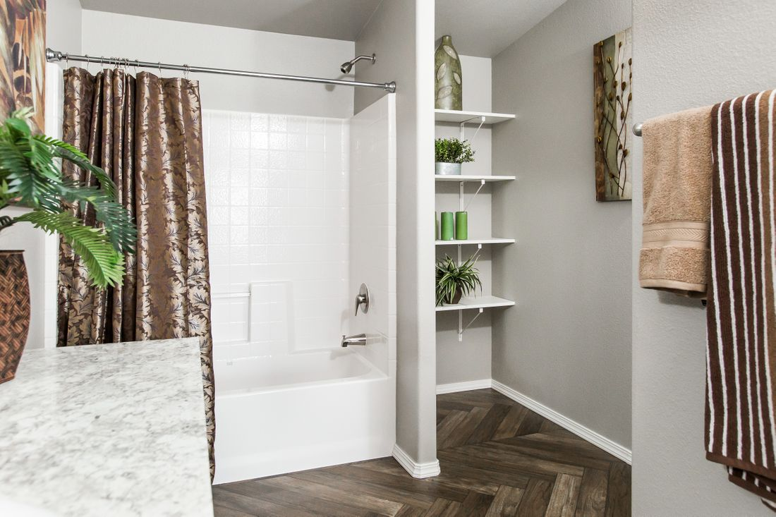 The 2017 COLUMBIA RIVER Master Bathroom. This Manufactured Mobile Home features 3 bedrooms and 2 baths.