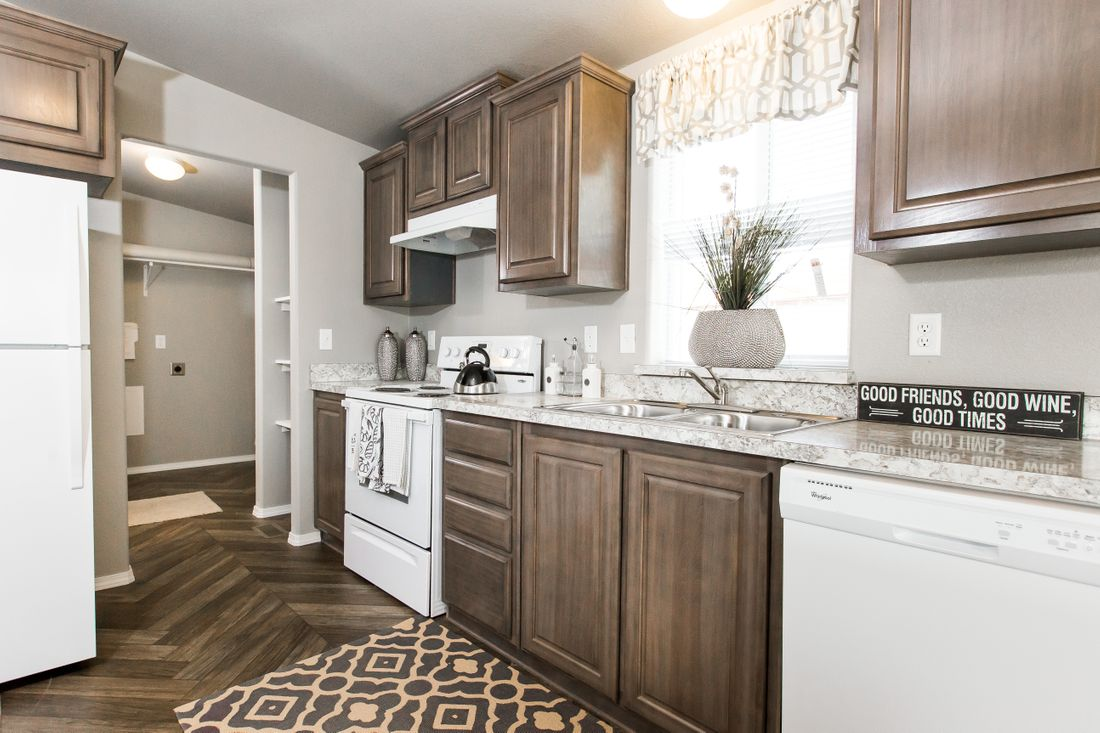 The 2017 COLUMBIA RIVER Kitchen. This Manufactured Mobile Home features 3 bedrooms and 2 baths.