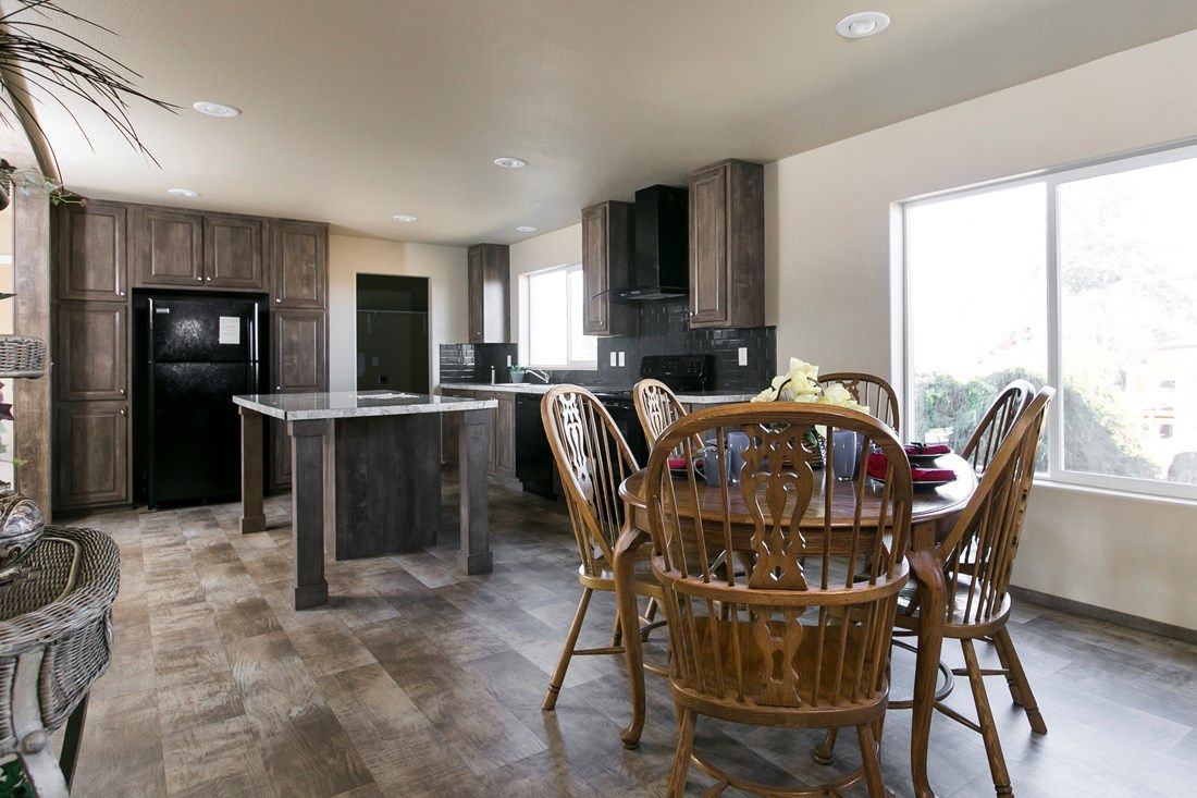 The 2022 COLUMBIA RIVER Dining Area. This Manufactured Mobile Home features 3 bedrooms and 2 baths.