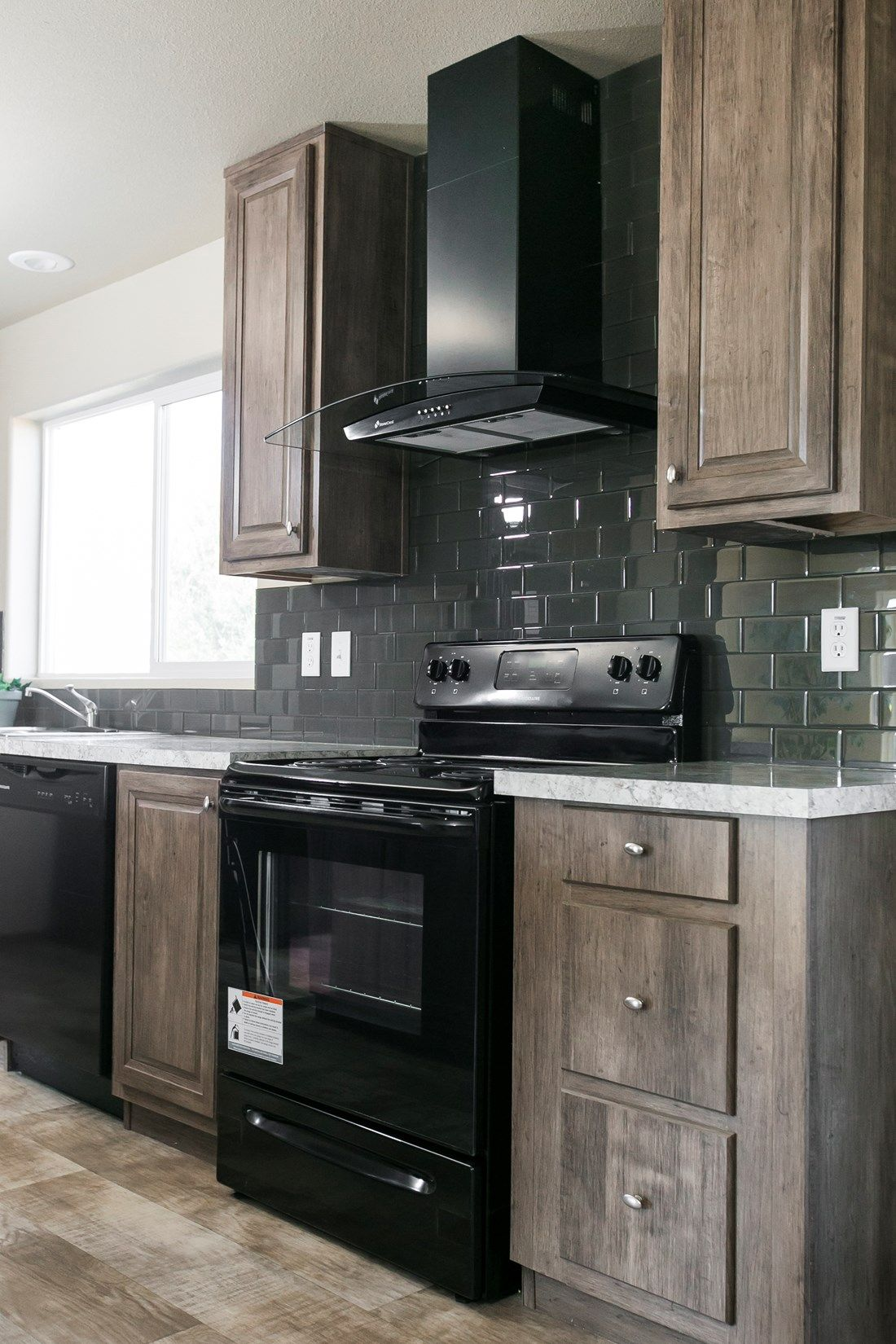 The 2022 COLUMBIA RIVER Kitchen. This Manufactured Mobile Home features 3 bedrooms and 2 baths.