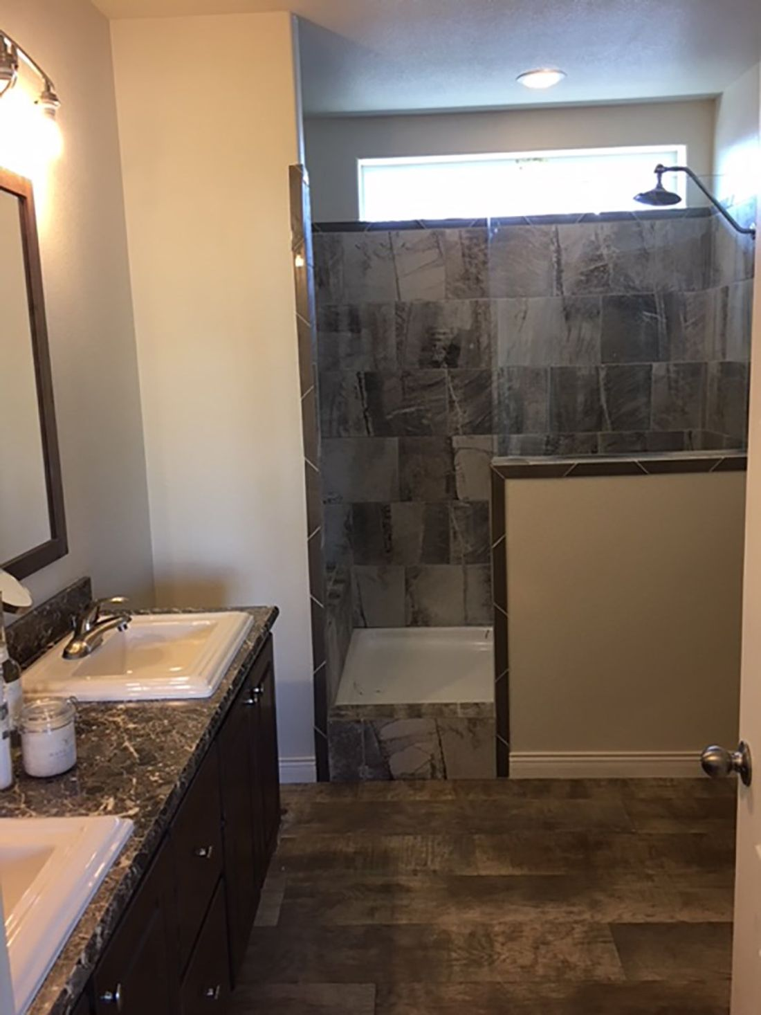 The 2024 COLUMBIA RIVER Master Bathroom. This Manufactured Mobile Home features 3 bedrooms and 2 baths.