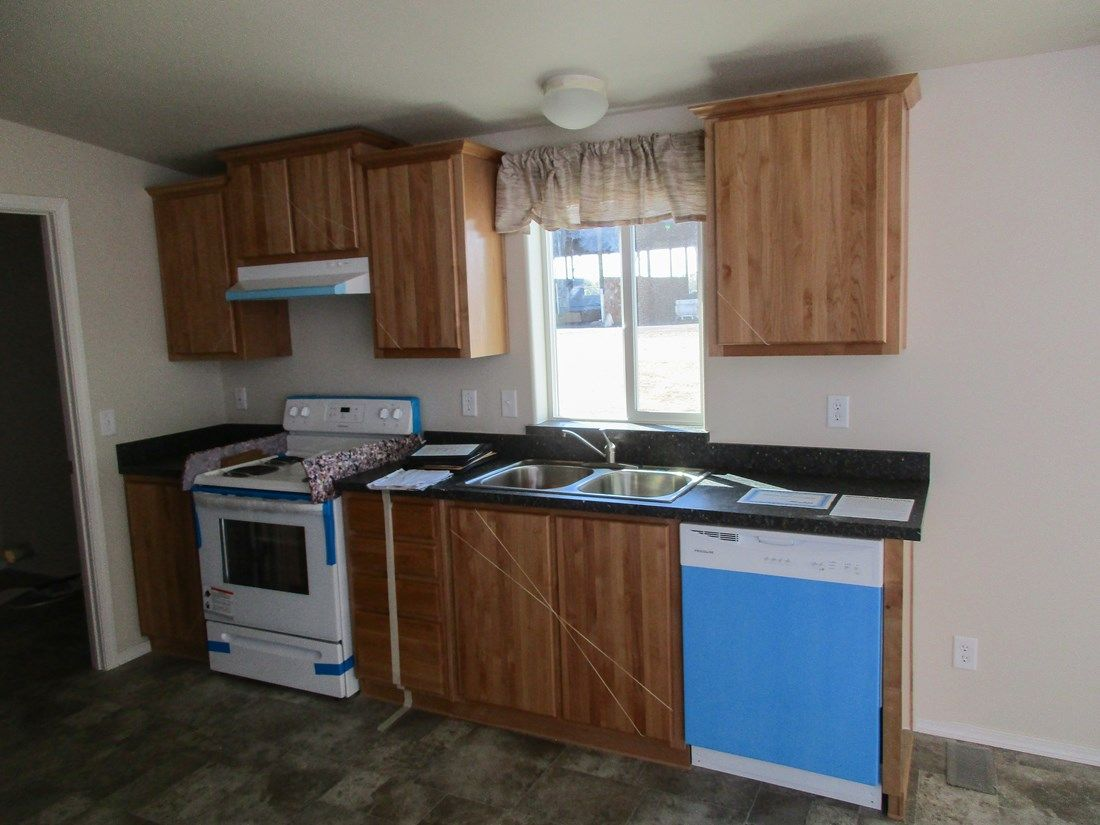 The 2025 COLUMBIA RIVER Kitchen. This Manufactured Mobile Home features 4 bedrooms and 2 baths.