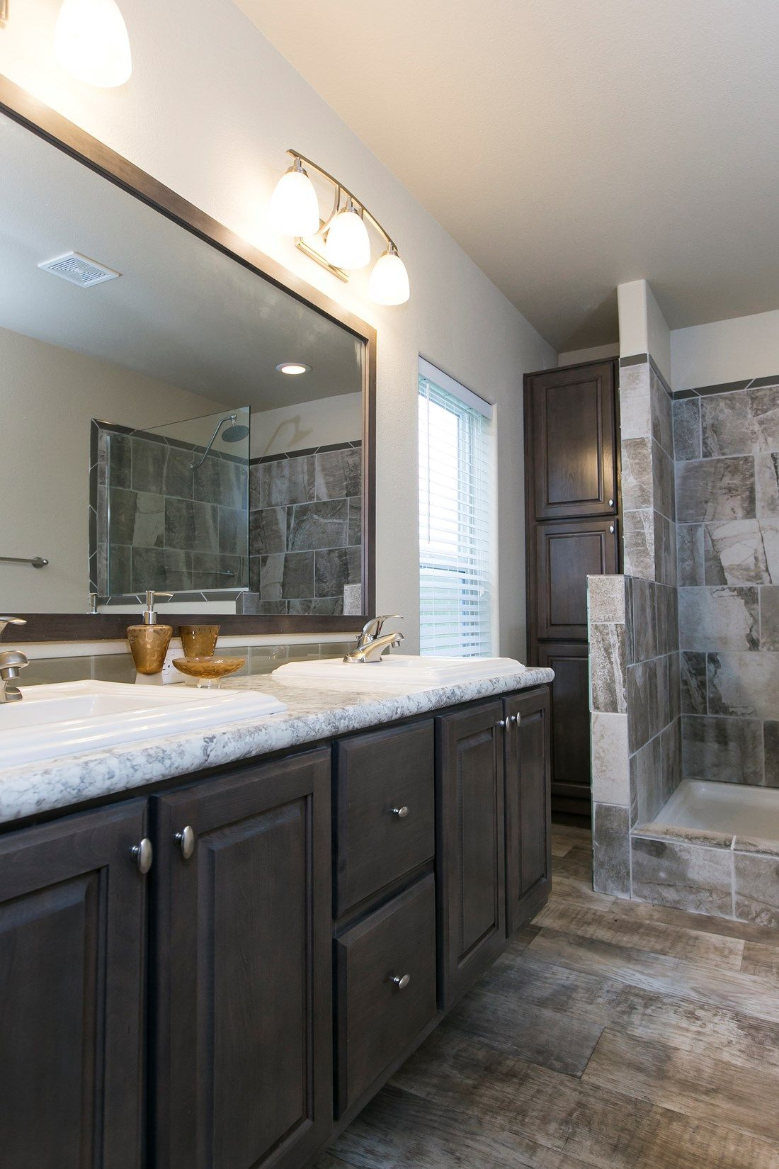 The 2023 COLUMBIA RIVER Master Bathroom. This Manufactured Mobile Home features 3 bedrooms and 2 baths.