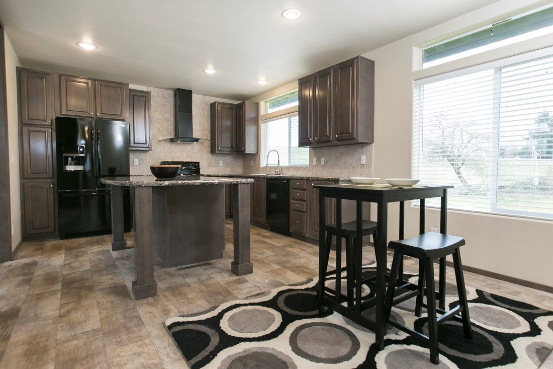The 2023 COLUMBIA RIVER Kitchen. This Manufactured Mobile Home features 3 bedrooms and 2 baths.