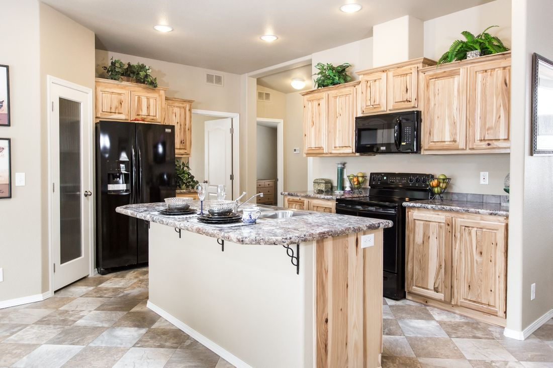 The 2027 COLUMIA RIVER Kitchen. This Manufactured Mobile Home features 4 bedrooms and 2 baths.