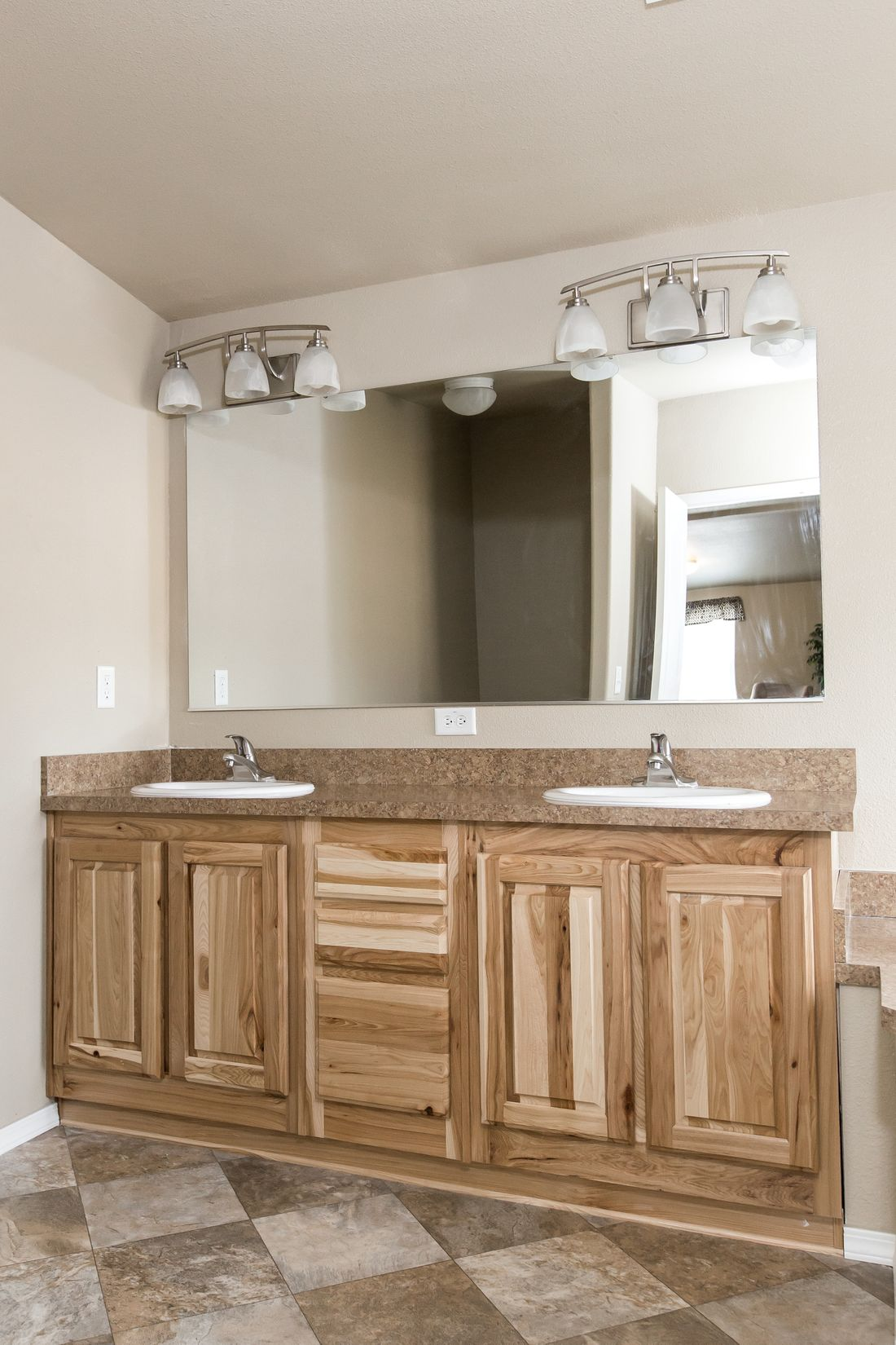 The 2027 COLUMIA RIVER Master Bathroom. This Manufactured Mobile Home features 4 bedrooms and 2 baths.