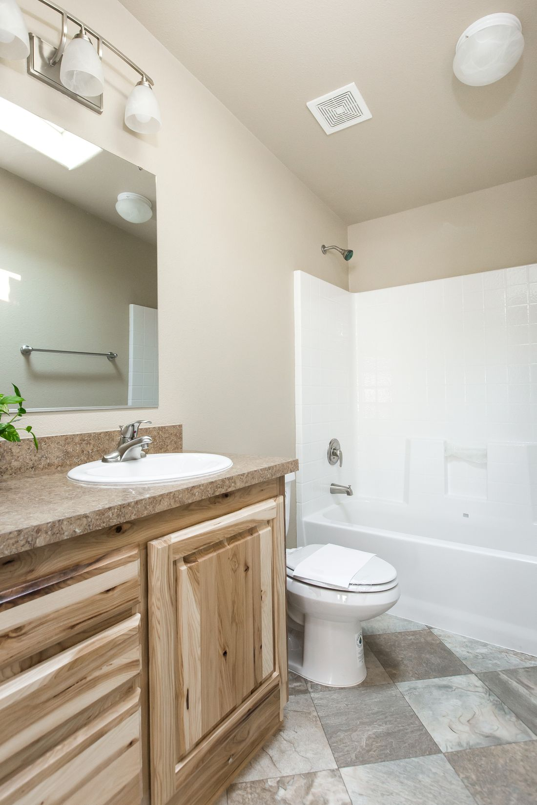 The 2027 COLUMIA RIVER Guest Bathroom. This Manufactured Mobile Home features 4 bedrooms and 2 baths.