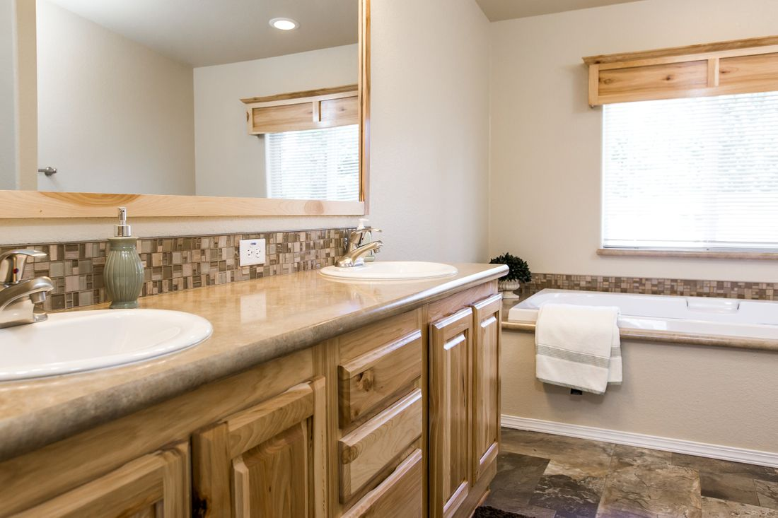 The 9590S BLACKMORE Master Bathroom. This Manufactured Mobile Home features 3 bedrooms and 2 baths.