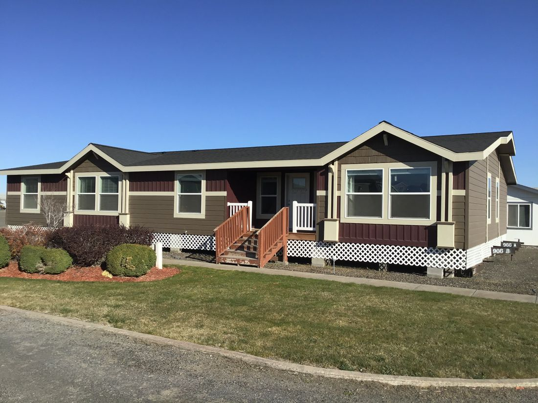 The 9593S         WASHINGTON Exterior. This Manufactured Mobile Home features 3 bedrooms and 3 baths.
