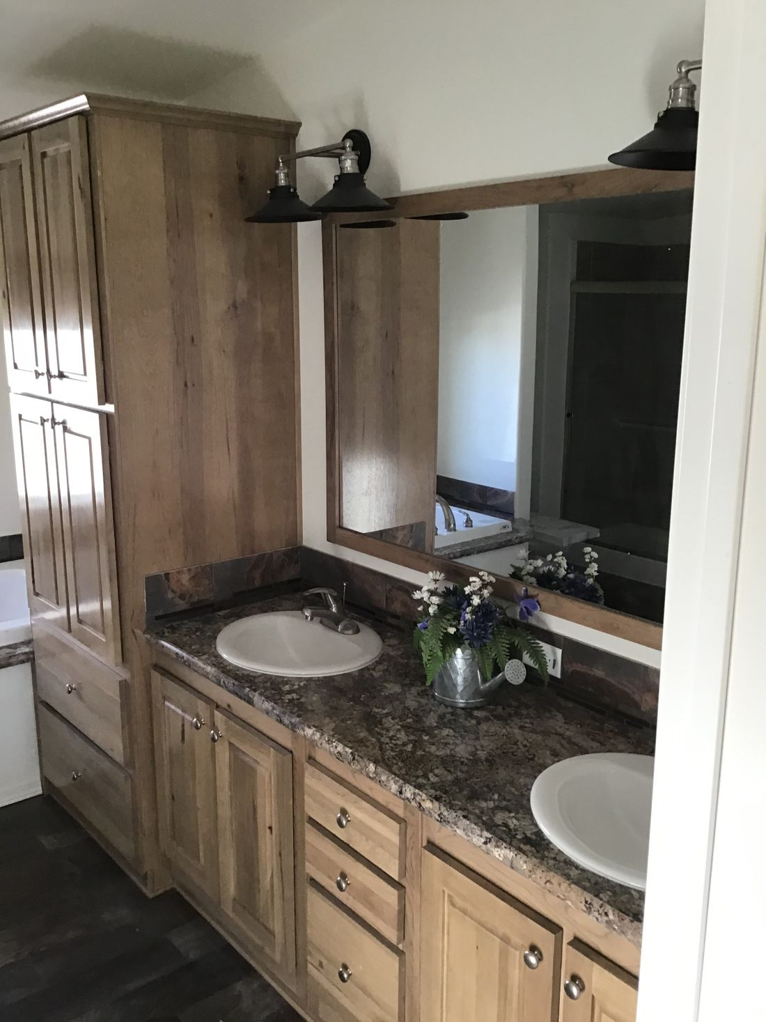 The 9593S         WASHINGTON Master Bathroom. This Manufactured Mobile Home features 3 bedrooms and 3 baths.