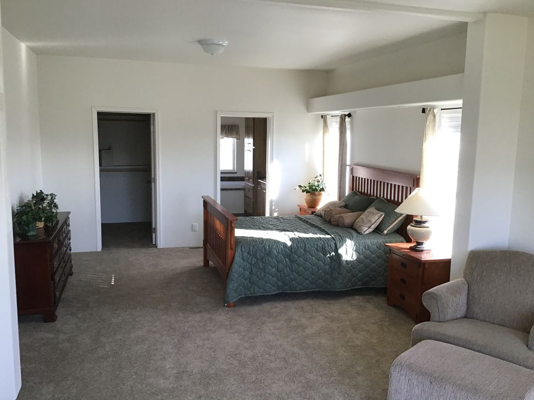The 9593S         WASHINGTON Master Bedroom. This Manufactured Mobile Home features 3 bedrooms and 3 baths.