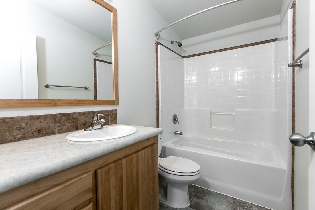 The 9598S BAKER Guest Bathroom. This Manufactured Mobile Home features 3 bedrooms and 2 baths.