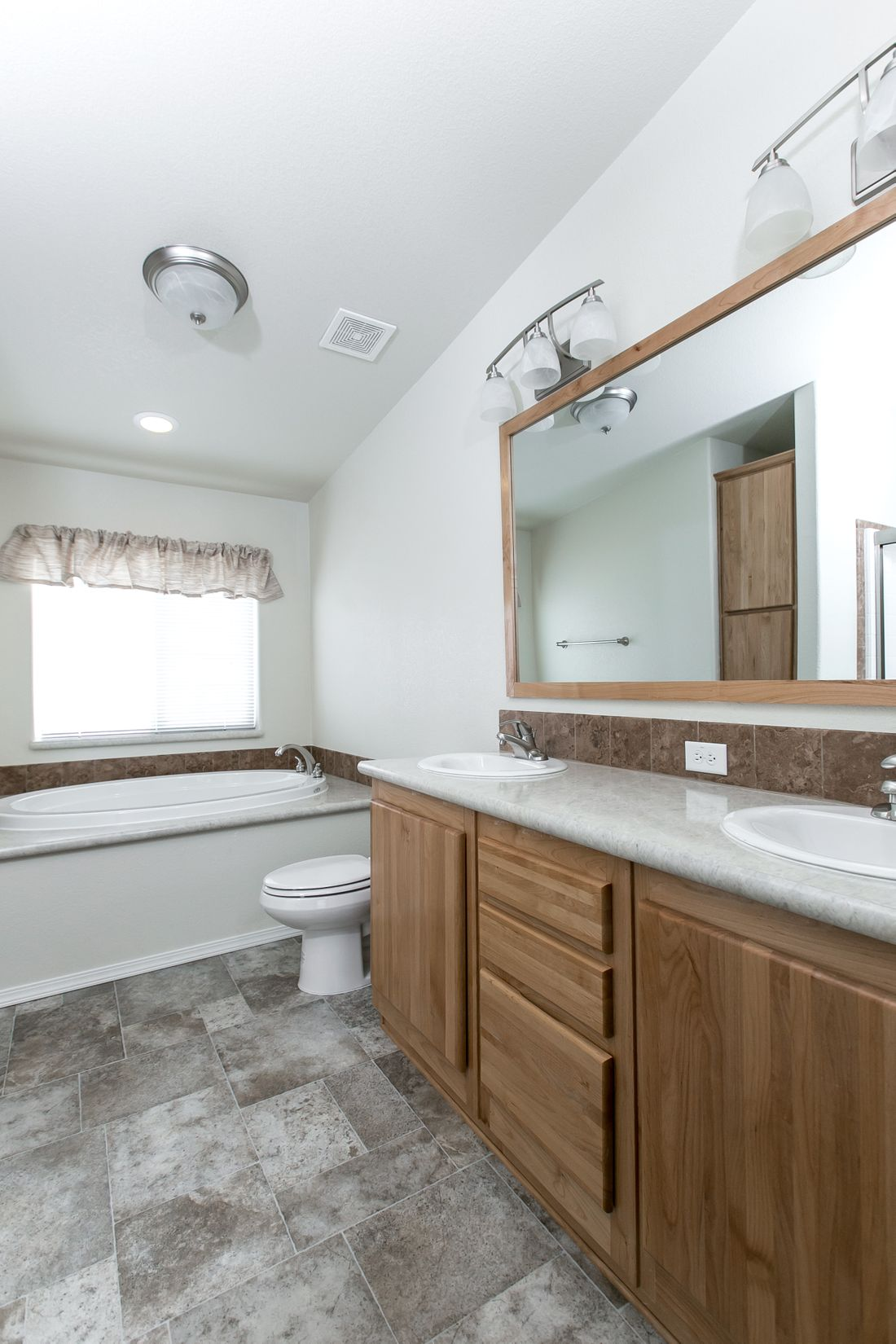 The 9598S BAKER Master Bathroom. This Manufactured Mobile Home features 3 bedrooms and 2 baths.