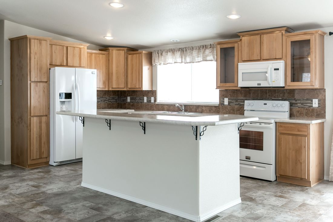 The 9598S BAKER Kitchen. This Manufactured Mobile Home features 3 bedrooms and 2 baths.