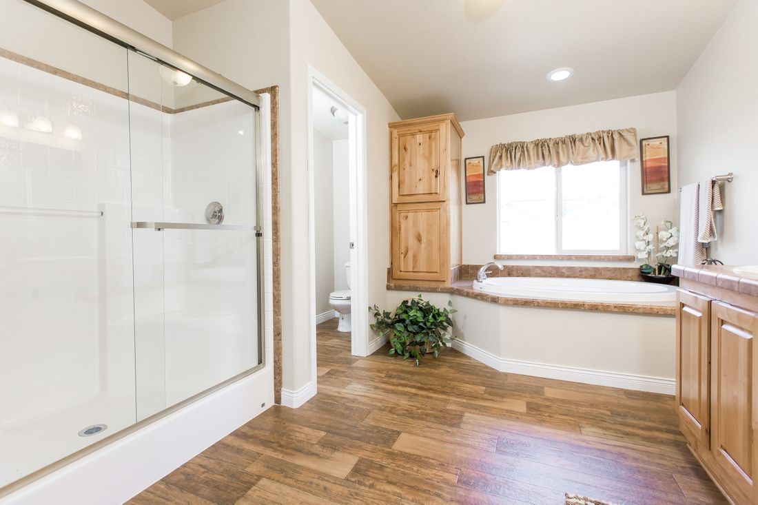The 9597S GLACIER PEAK Master Bathroom. This Manufactured Mobile Home features 3 bedrooms and 2 baths.