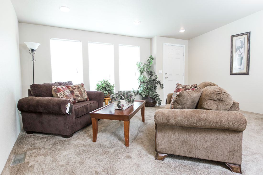 The 2860 MARLETTE SPECIAL Living Room. This Manufactured Mobile Home features 3 bedrooms and 2 baths.