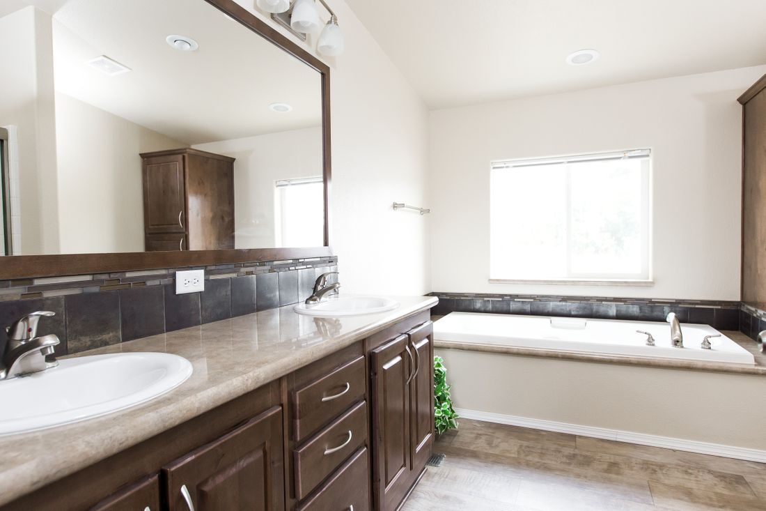The 2860 MARLETTE SPECIAL Master Bathroom. This Manufactured Mobile Home features 3 bedrooms and 2 baths.